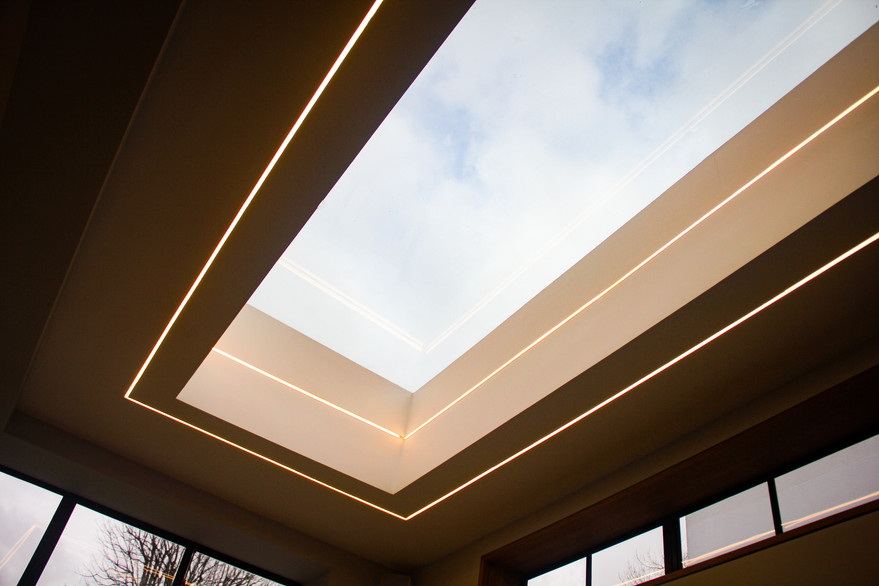 Monster skylight with recessed feature lighting