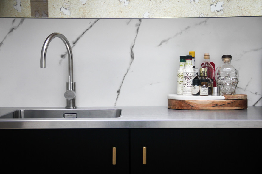 Bar area Dekton slashpback with stainless steel elements to compliment the kitchen