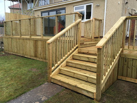 Raised softwood decking with steps & balustrades