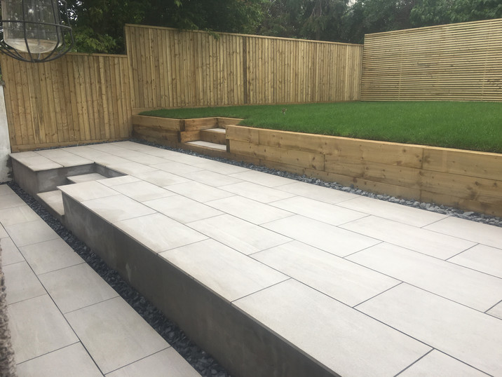 Porcelain paving within tiered garden design