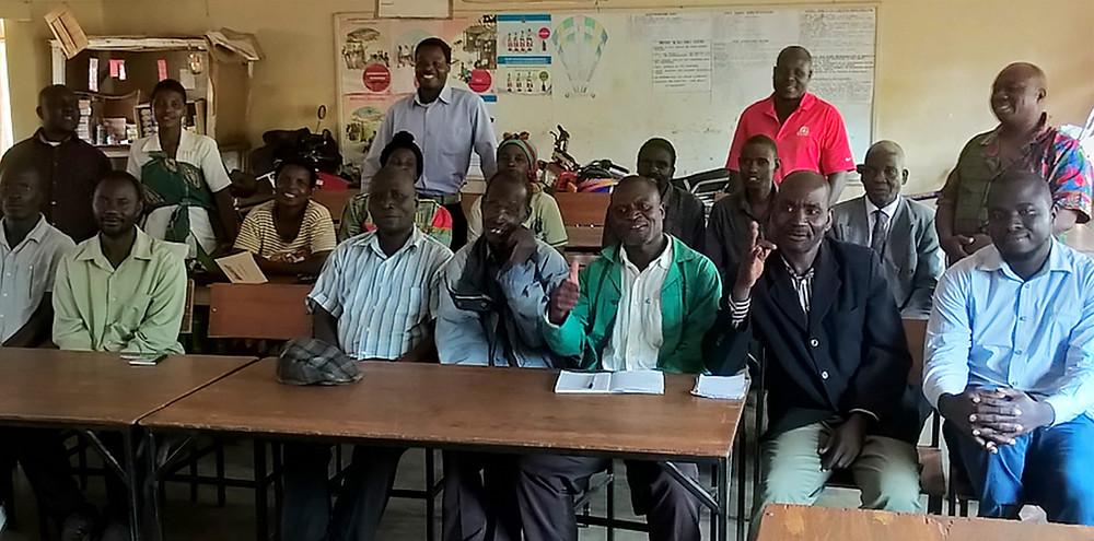 Farmers and committee members in the local school where we met