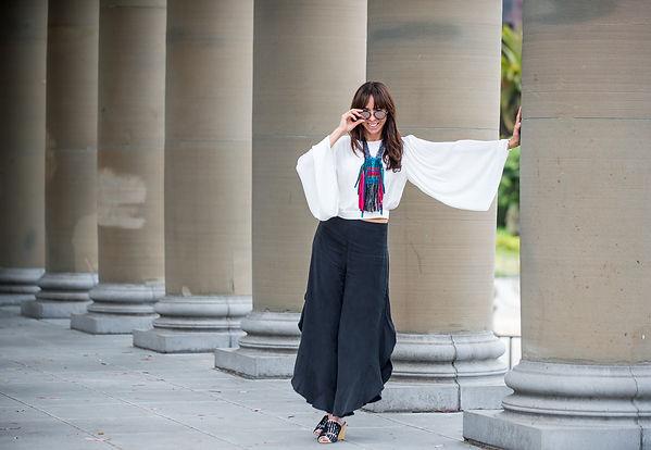 Artist Steff Goodman wearing her woven necklace in Golden Gate Park
