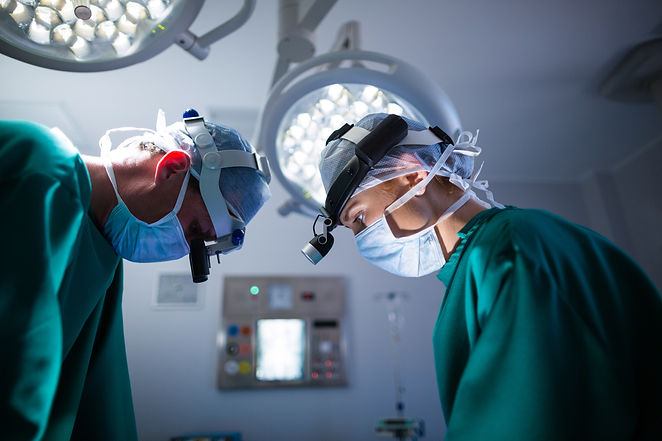 surgeons-wearing-surgical-loupes-while-p