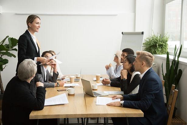 successful-female-boss-leading-team-meet