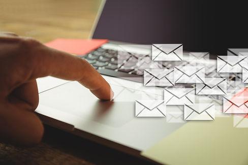 hand-tounching-laptop-many-envelopes (1)