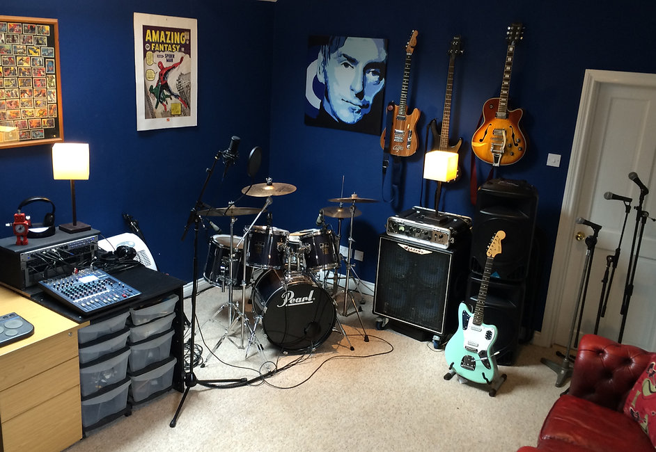 Live room drum kit and guitars