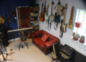 Studio live room with piano and instruments