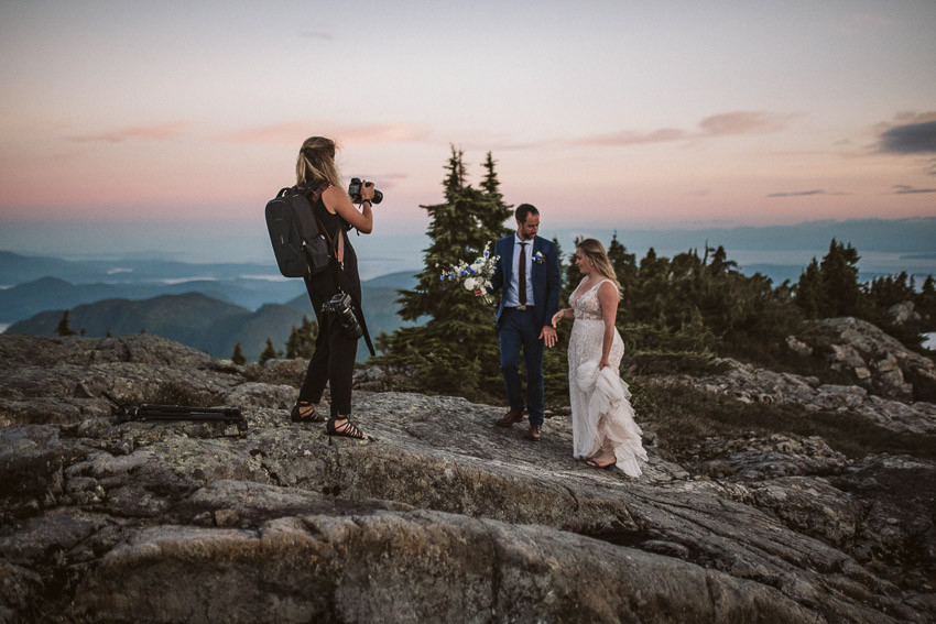 Wedding Videographer on top of Mountain filming newly weds. Flew from Campbell River, BC.