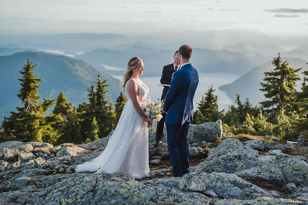 Campbell River Wedding Photographer takes photos of newly weds getting married on top of a mountain. 49 North Helicopters flew a group of us to a mountain top.