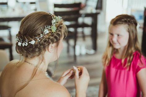 Campbell River Wedding Photographer taking 'getting ready' images of bride with her neice