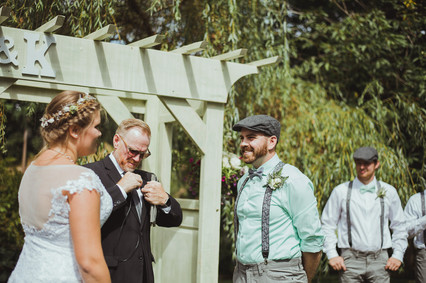 Campbell River Wedding Photographer at Haig Brown House Wedding Venue. Bride and Groom are smiling at eachother
