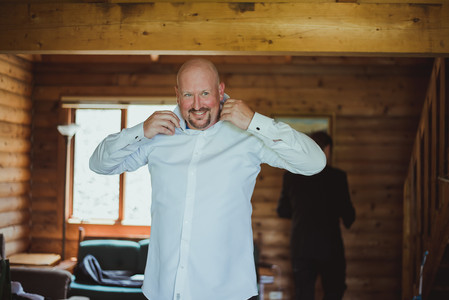 Groom getting ready for his telegraph Cove wedding photographed by Vancouver Island Wedding Photographer