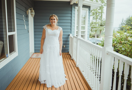 Campbell River Wedding Photographer taking 'getting ready' images of bride in her wedding dress