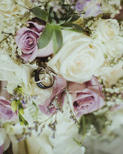 Campbell River Wedding Photographer taking photo of wedding rings in bouquet