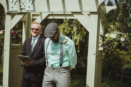 Campbell River Wedding Photographer takes photo of Groom waiting for his bride