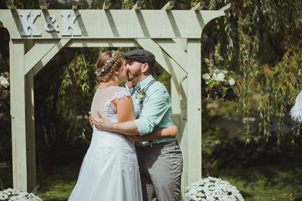 Campbell River Wedding Photographer at Haig Brown House Wedding Venue. Bride and Groom share their first kiss