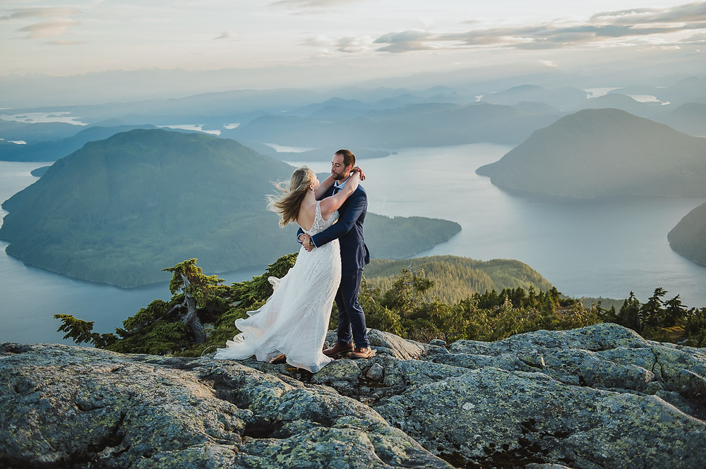 Wedding Photography on top of a mountain! Wedding elopement from Campbell River BC, newly weds are standing on a mountain overlooking the ocean.