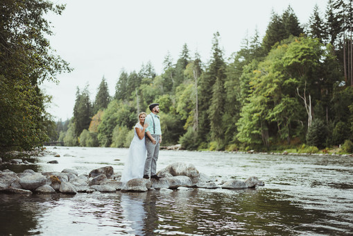 Wedding Photographer at Outdoor Campbell River, BC Wedding takes photos along the river