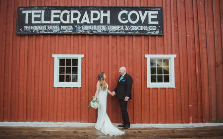 Bride and Groom under telegraph cove sign