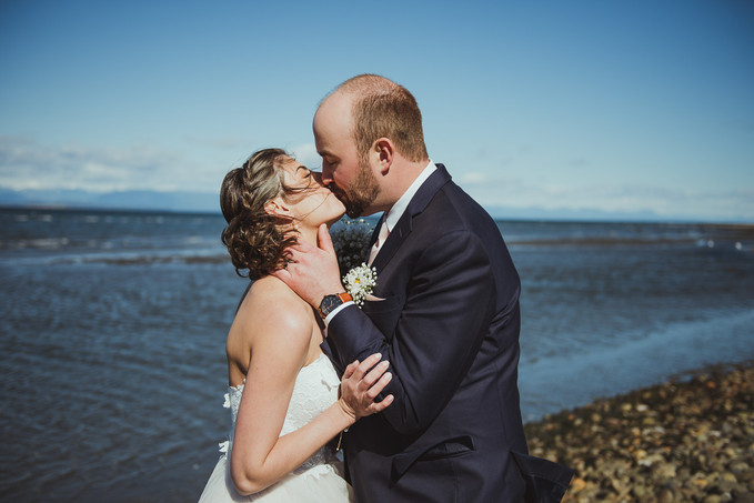 Beach wedding in campbell river at oyster bay resort. bride and groom share their first look