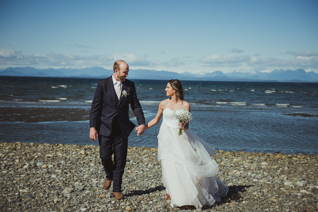 Campbell River Wedding Photographer taking photos of bride and groom at the beach