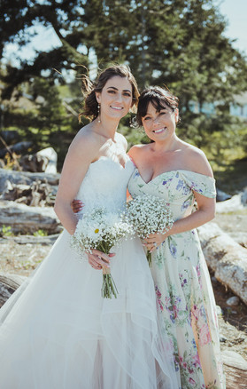 Campbell River and Victoria BC Wedding Photographer with bride and her bridesmaid on the beach