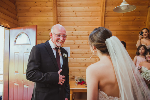 Wedding Videographer captures dad's first look of his daughter, the bride.