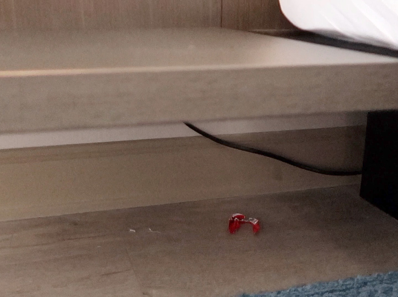 Wrapper under bedside table