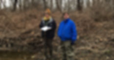 Streamkeepers recording observations at their site