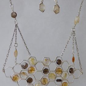 Silver Beecomg (set): Handmade hex-shapes hold Citrine, Smoky and Rutilated Quartz discs. $320