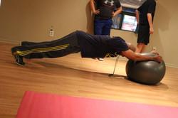 Demonstrating an advance plank