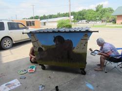 Rikki Clymore beautifying a dumpster