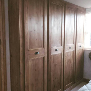 Floor to ceiling pine fitted wardrobe