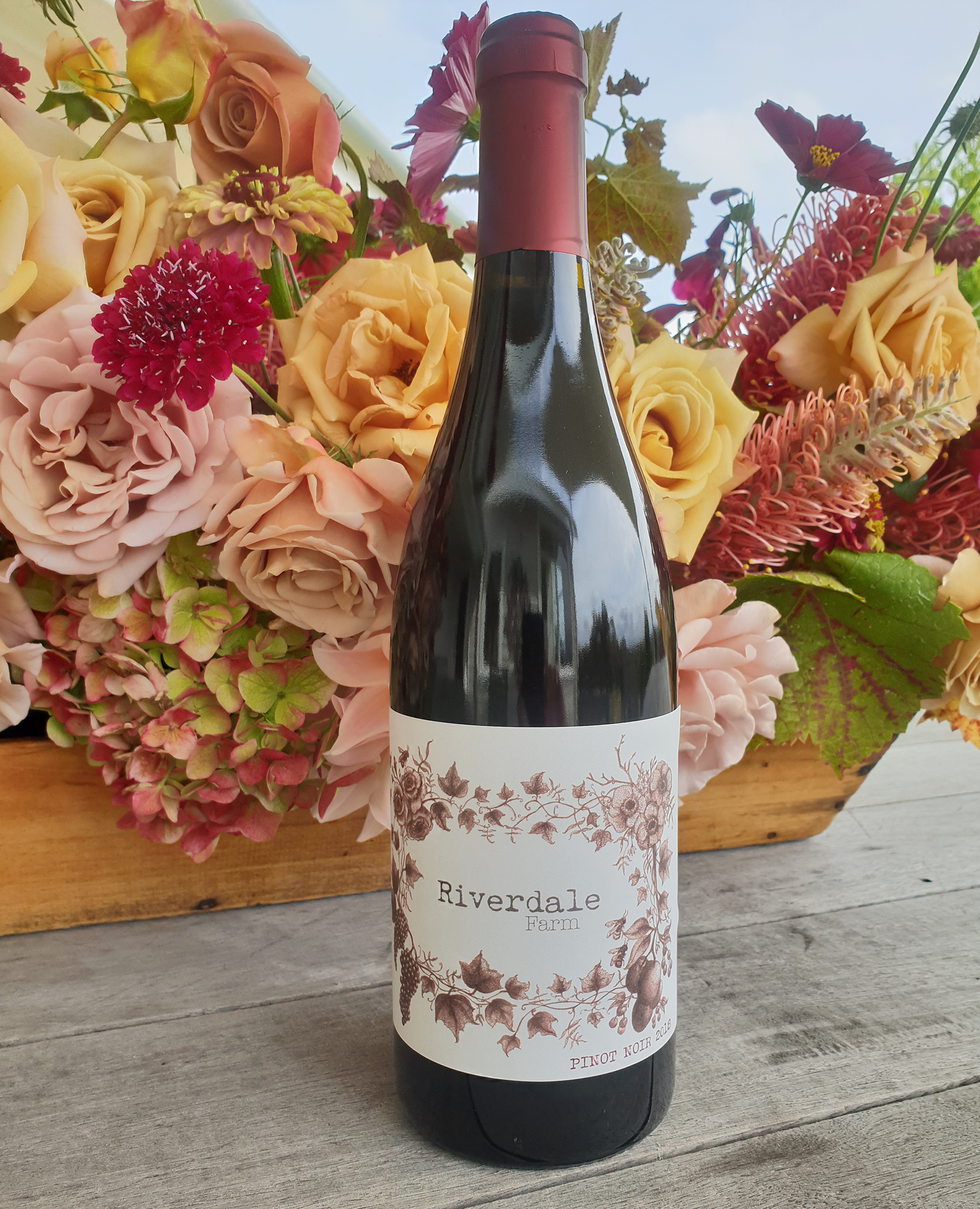 Autumnal flowers and Riverdale Farm pinot noir