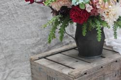 Pewter jug of flowers