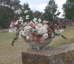 Urn of summer blooms