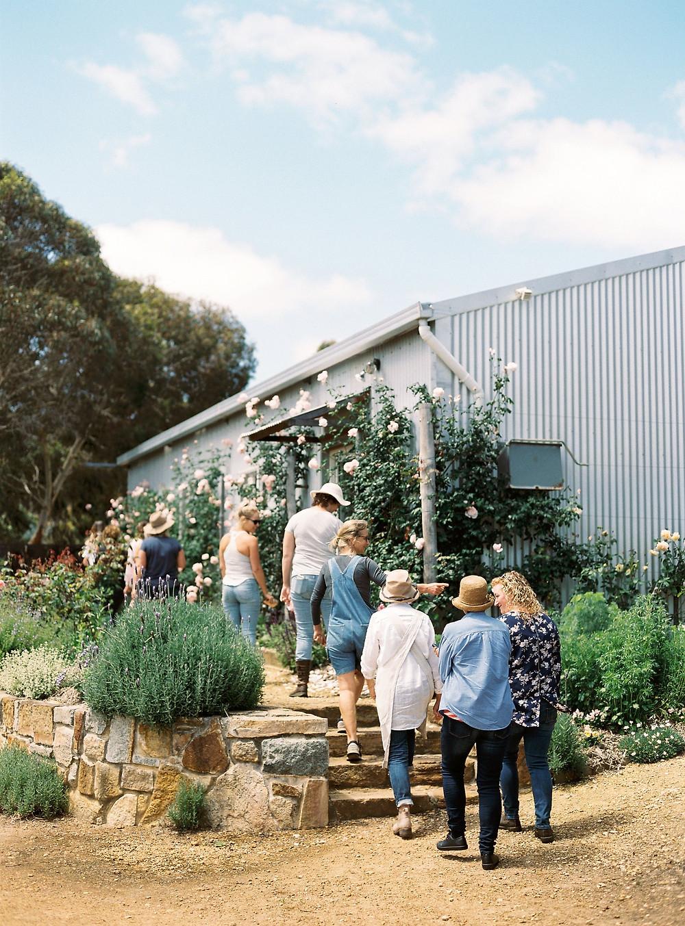 Workshop participants having a garden tour at Riverdale Farm.