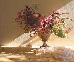 Urn arrangement with garden flowers