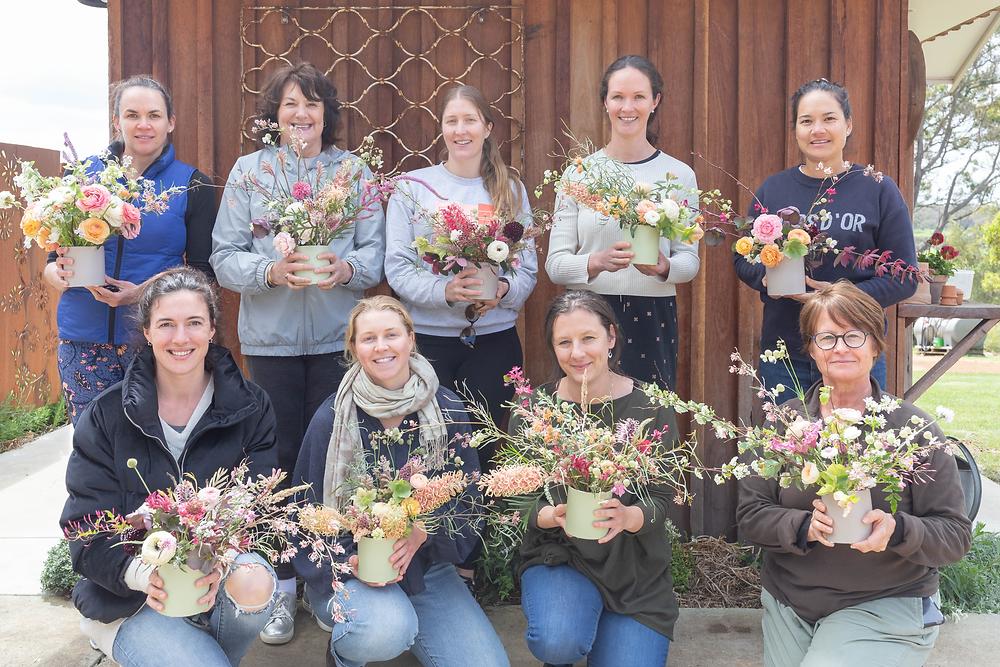 MedArtation participants with their floral creations to take home and enjoy at home.