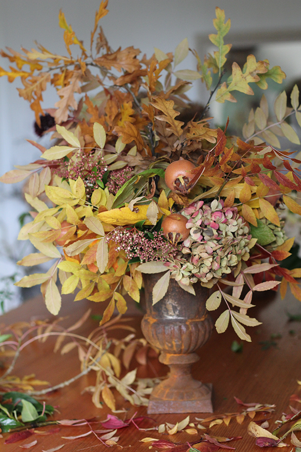 Autumn foliage and fruit arrangement