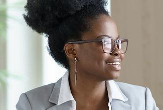 smiling-afro-woman-in-blazer-wear-glasse