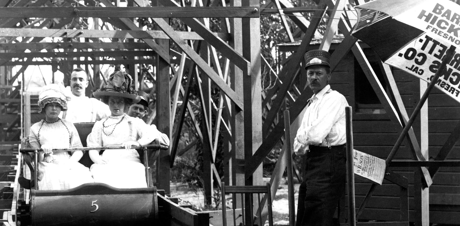Zapp's Park RollerCoaster with two rides in car number 5 ready to enjoy a rickety adventure. Taken in 1911 by Pop Laval.
