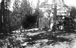 M073 Family in front of Starkey cabin at