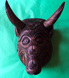 Hand-carved wall mask