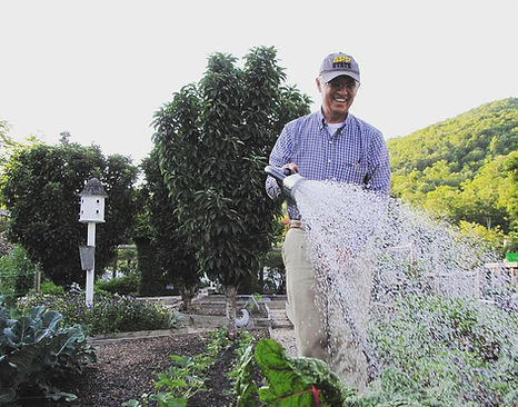 Dr. Stanley watering plants.