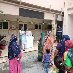 DAV, R.K. Puram with Khushiyan Foundation distributes daily requirements to underprivileged.