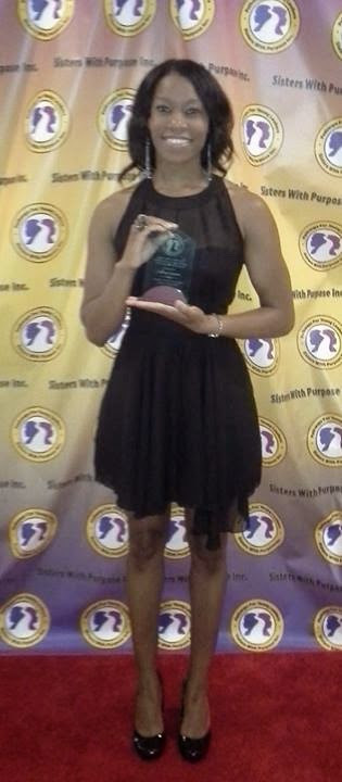 Courtney after she received her award