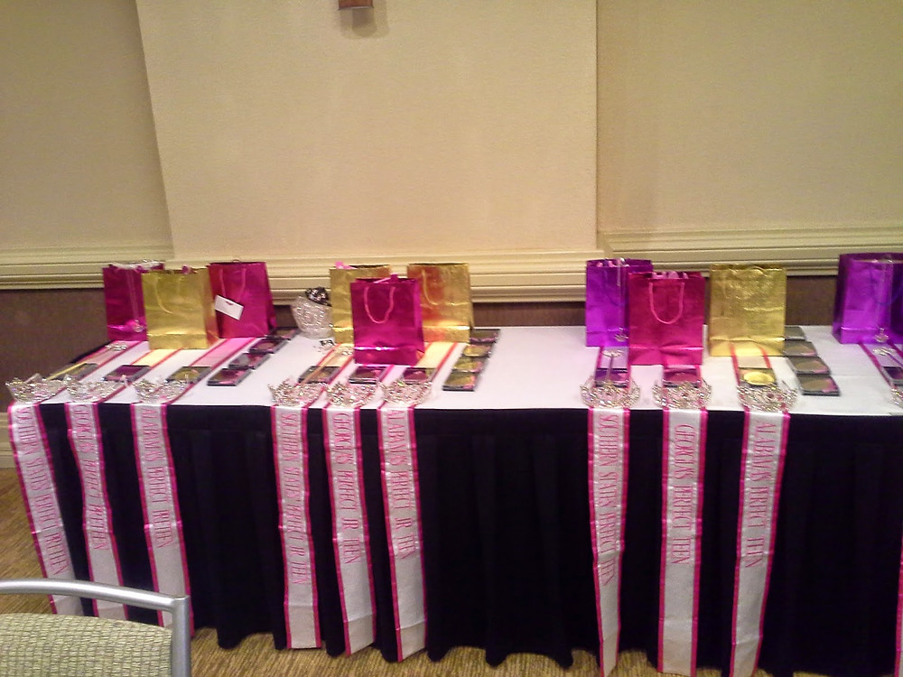 Setting the prizes, sashes, and crowns up