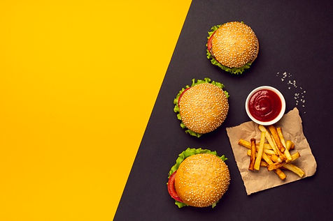 flat-lay-burgers-with-french-fries_23-21