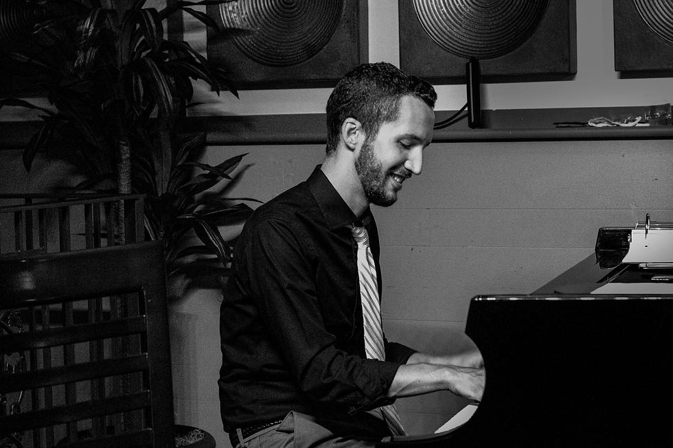 playing piano at panzas.png
